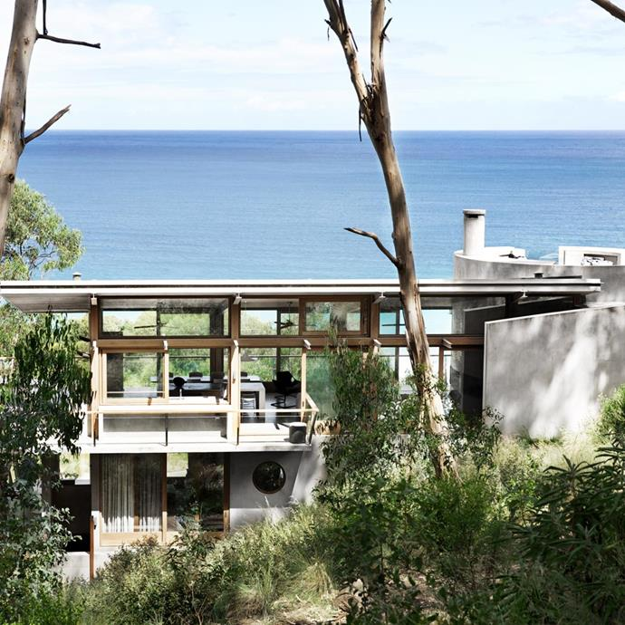 """The two personalities of the house really work together. The concrete section that houses the bedrooms is very purposeful, sheltering the house from storms and deadening sound, in contrast to the noises of nature in the living section,"" he says. Image via [Robert Mills Architects and Interior Designers](http://www.robmills.com.au/ocean-house/ 