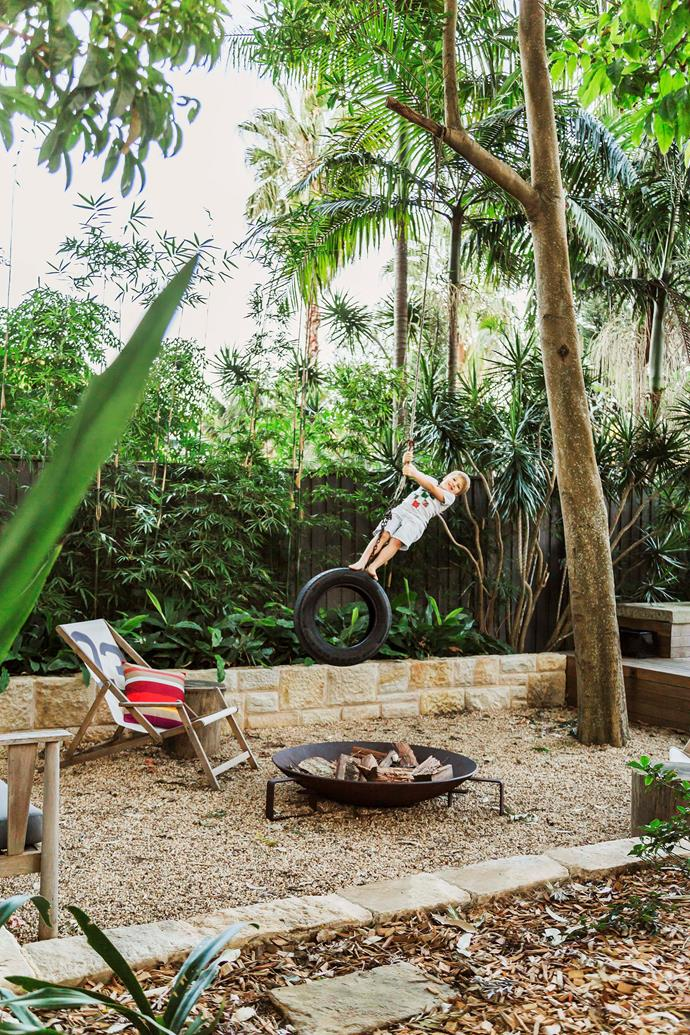 The landscaped backyard of this [Sydney home](http://www.homestolove.com.au/gallery-a-family-friendly-beachside-home-2479) is divided into several zones that make it highly functional for both kids and adults. Fun can be had swinging on a tyre or gathering around the fire pit.