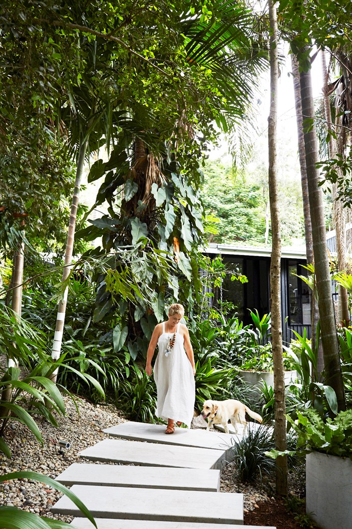 Vanessa traverses a walkway of custom-made concrete pavers with Rio, a golden labrador withdrawn from the Seeing Eye Dogs Australia program for being too 'flighty' but now in her element as a much-loved pet.