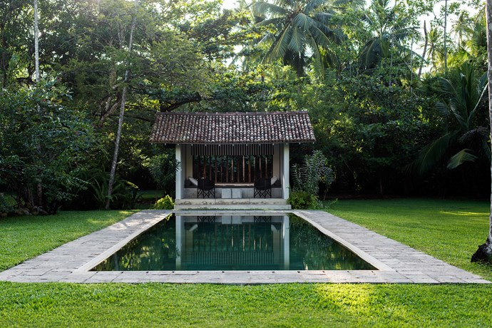 A pavilion beside the pool is one of several indoor/outdoor spaces on the property.