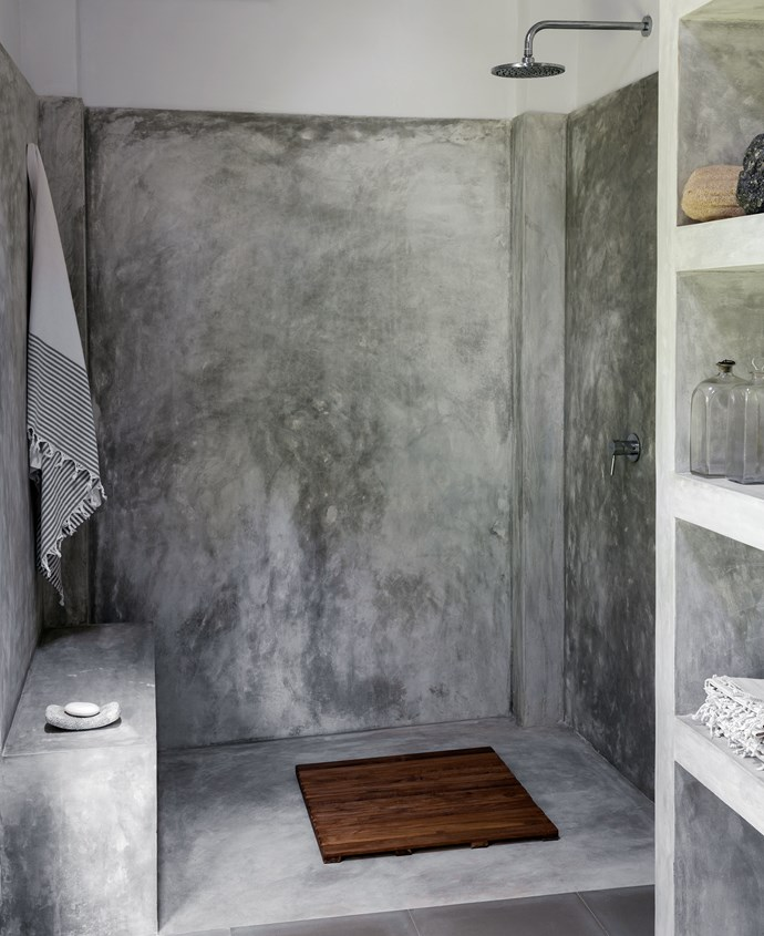 The shower in the garden room has polished cement walls, a slatted wood mat from Barefoot, Colombo, and a hammam towel from the Grand Bazaar, Istanbul.