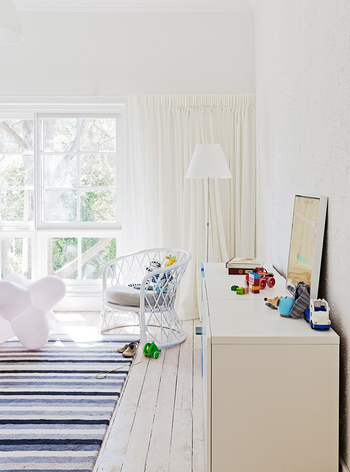 Aston's bedroom also benefits from the crisp white palette – it will work for him even as he gets older – with a few blue accents, perfect for a boy.