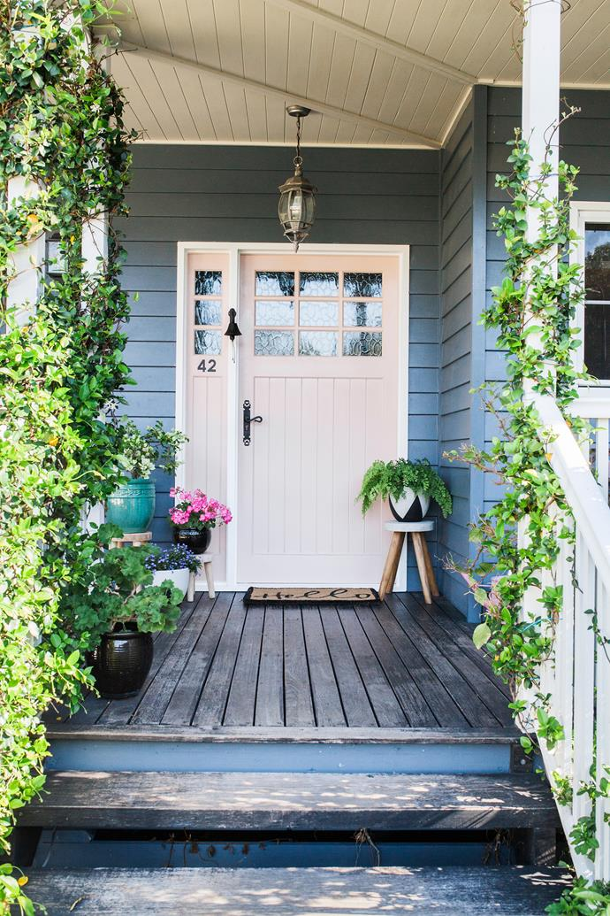 The style of front door, paintwork and the climbing plants combine to extend a warm country welcome.