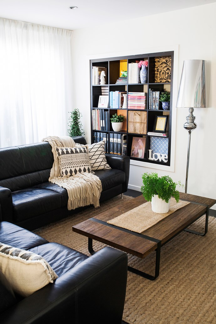 Dark solid furniture is the perfect choice for this large light room. Leather sofas and coffee table are from Freedom.