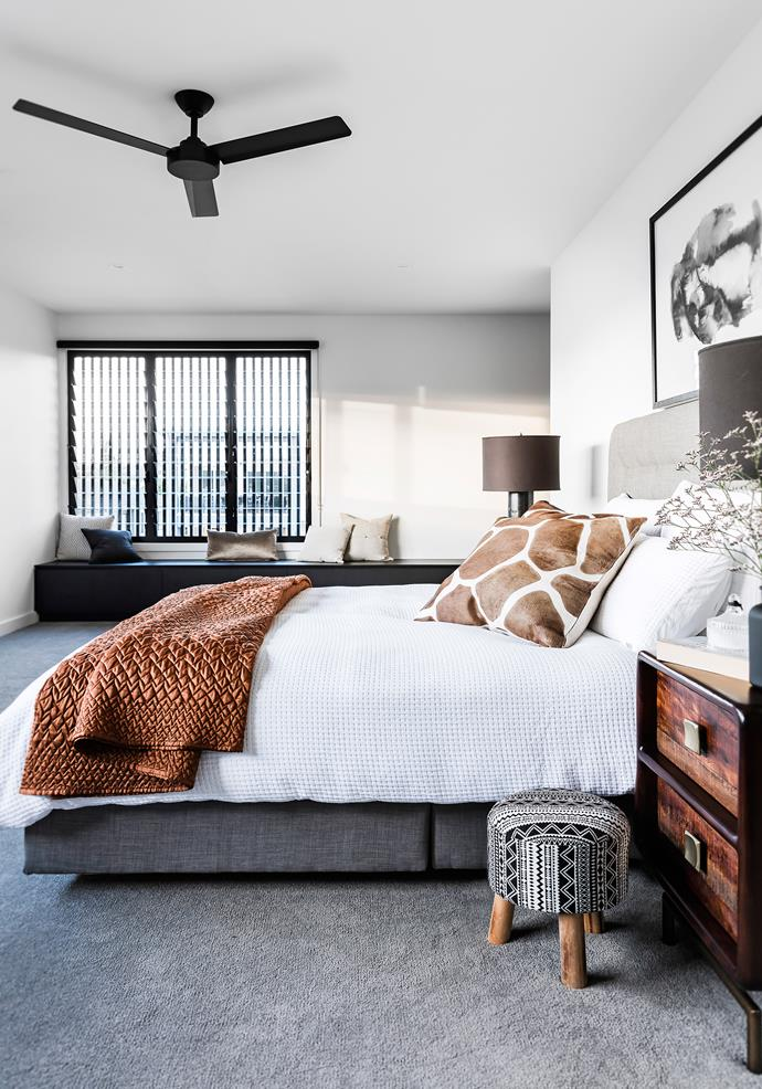 The generous main bedroom suite is thoughtfully designed, with a walk-through wardrobe behind the bedhead wall and an ensuite next door.