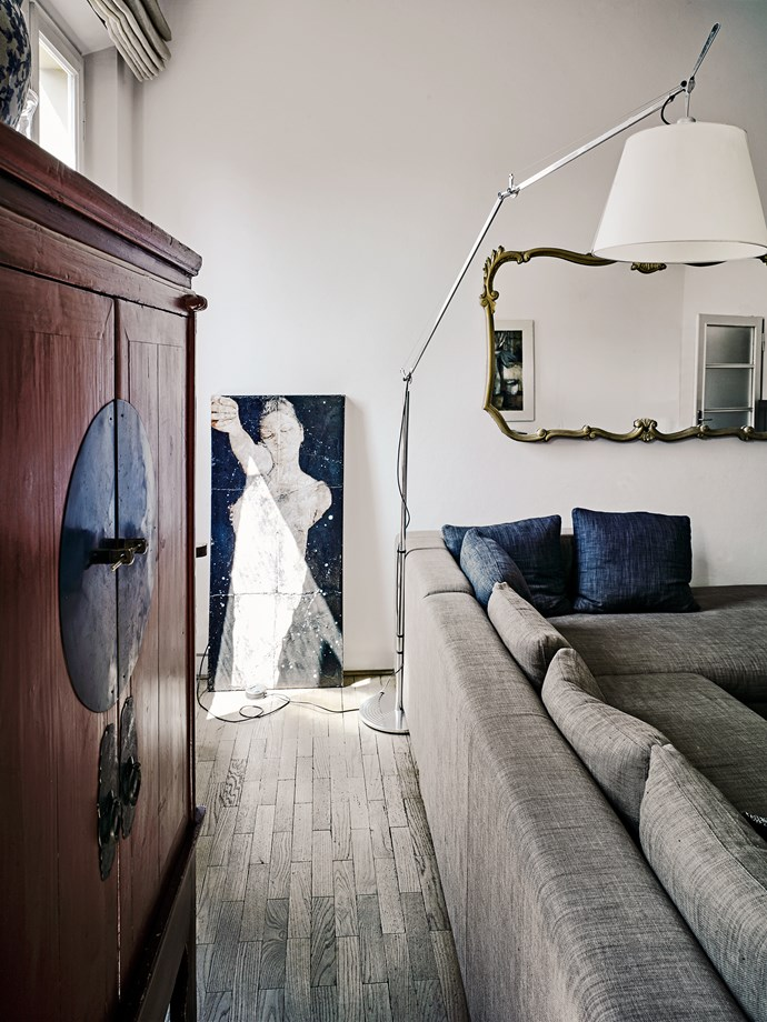 Designer Benta Wiley believes in buying timeless pieces like this Minotti sofa, the Tolomeo floor lamp and an old Chinese cabinet. The painting is by an Italian artist Massimo Lagrotteria.