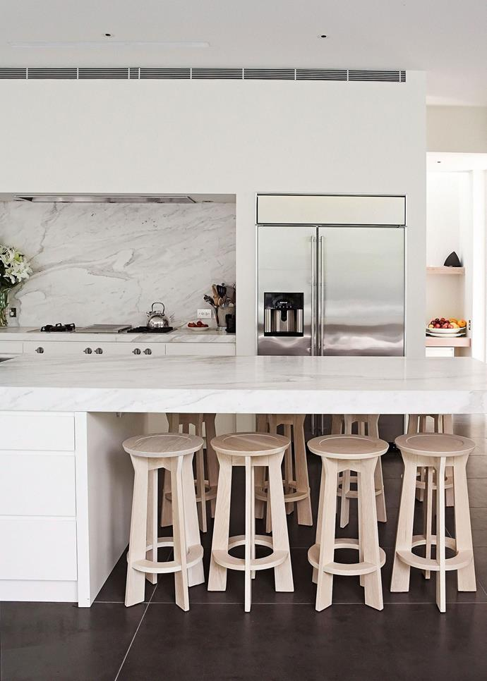 A marble benchtop is the pièce de résistance in this white and grey entertainer's kitchen.