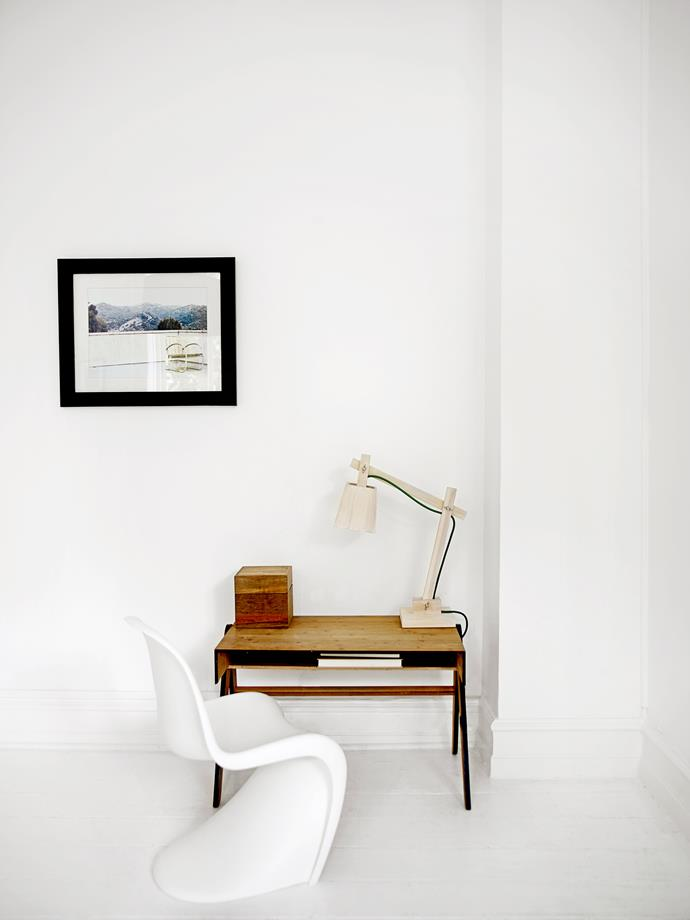 """A study nook created for Marvin consists of a small wooden desk, a Vitra """"Panton Junior"""" chair and a Muuto """"Wood"""" lamp."""