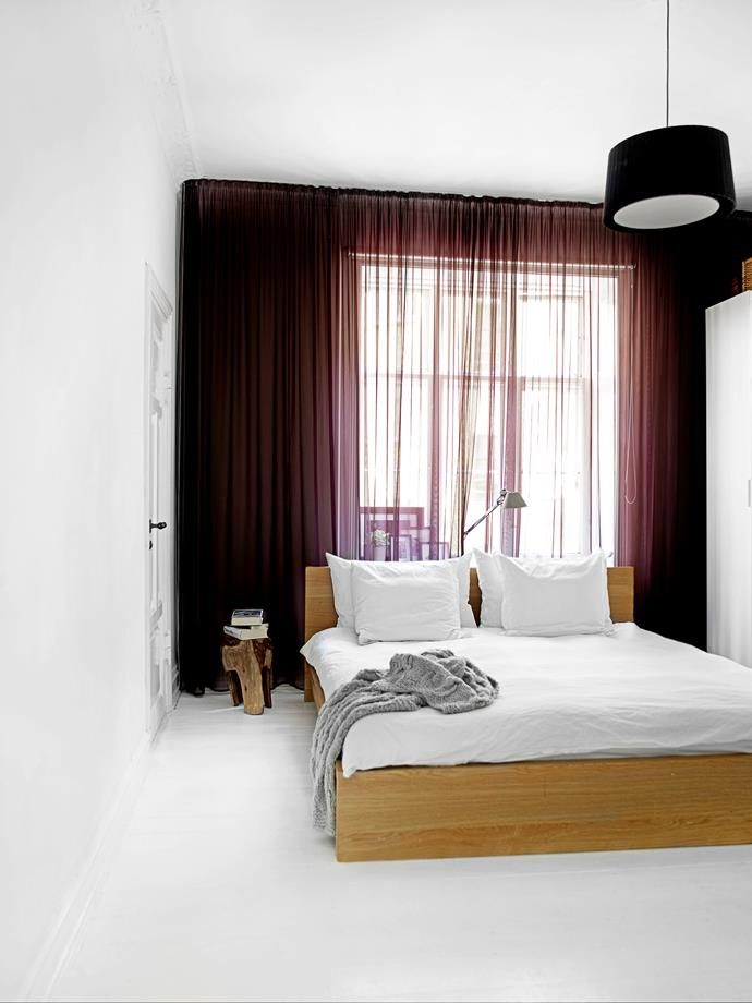 Sheer curtains allow natural light to gently seep into the master bedroom creating a calm, cosy atmosphere.