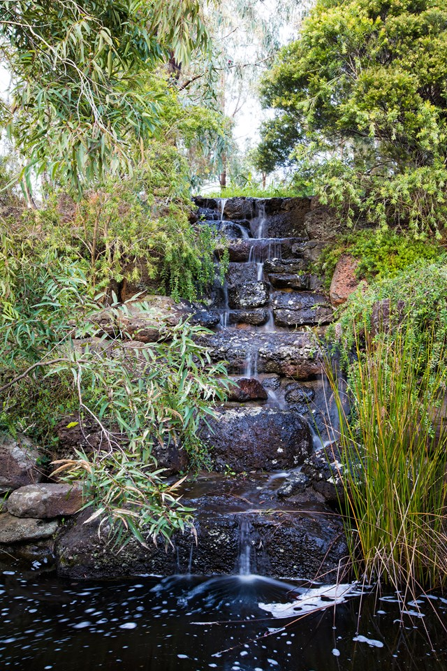 """A soothing soundscape is created by this basalt waterfall in a [bushland retreat 30 minutes out of Melbourne's CBD](https://www.homestolove.com.au/a-bushland-retreat-30-minutes-out-of-melbournes-cbd-4883