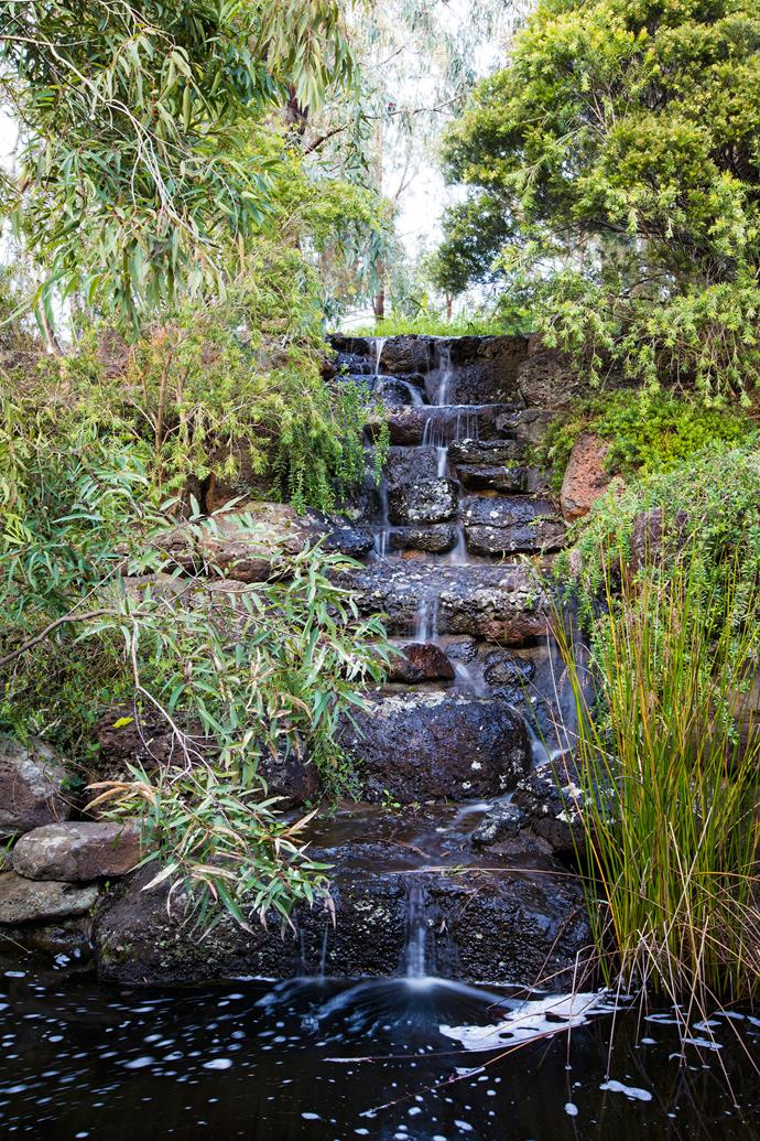 The waterfall, made from basalt, creates a soothing soundscape.