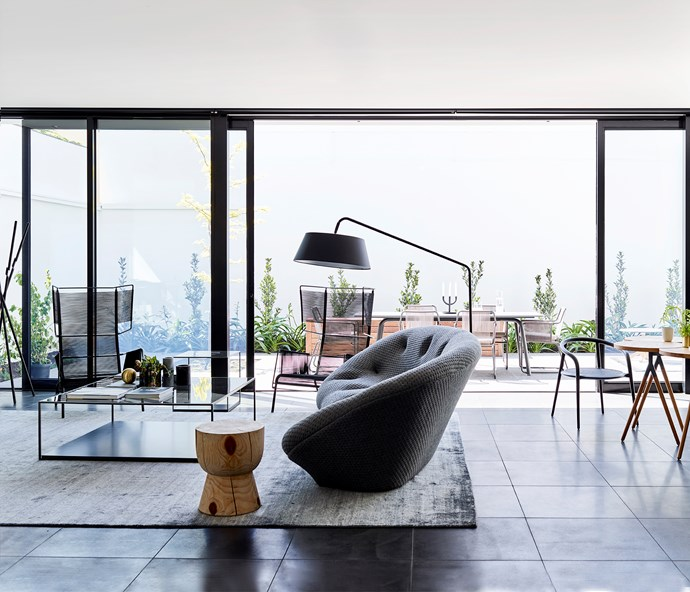 Ligne Roset 'Ploum' large settee, 'Bul' lamp and 'Fifty' lounge chairs with Duvivier 'Karusa' coffee table and side table, all from Domo. Rug from Cadrys. 'Eggcup' stool from Mark Tuckey.