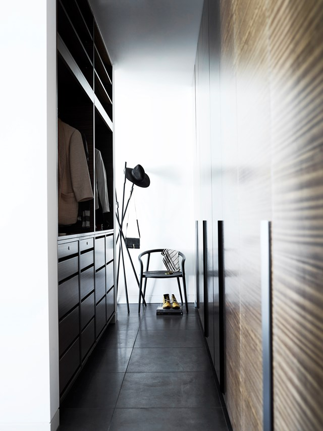 "An edgy walk-in robe lines the corridor leading up to this [luxurious Melbourne apartment's](https://www.homestolove.com.au/a-luxury-melbourne-apartment-styled-by-simone-haag-4895|target=""_blank"") master bedroom. A mix of open and concealed shelving add functionality while the layering of textures adds interest to the space. *Photo: Mark Roper 