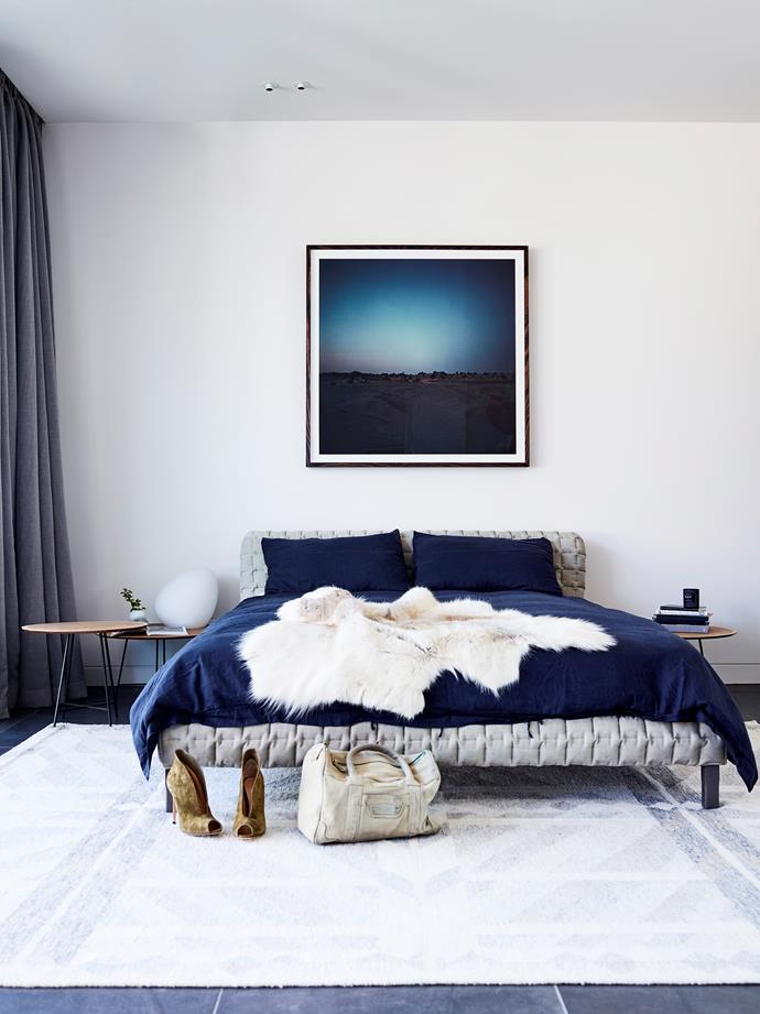 Ligne Roset 'Ruché' bed, 'Alburni' side tables and 'Dolmen' light, all from Domo. Chris Warnes print from Otomys. Bed linen from In Bed. Hide throw from Great Dane. Rug from Cadrys.