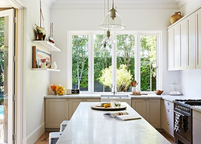 Whites, windows and transparent pendant lights help provide a sense of openness in the kitchen of this [renovated circa-1905 Federation villa](http://www.homestolove.com.au/federation-villa-enters-the-21st-century-3470). *Photo: Armelle Habib*