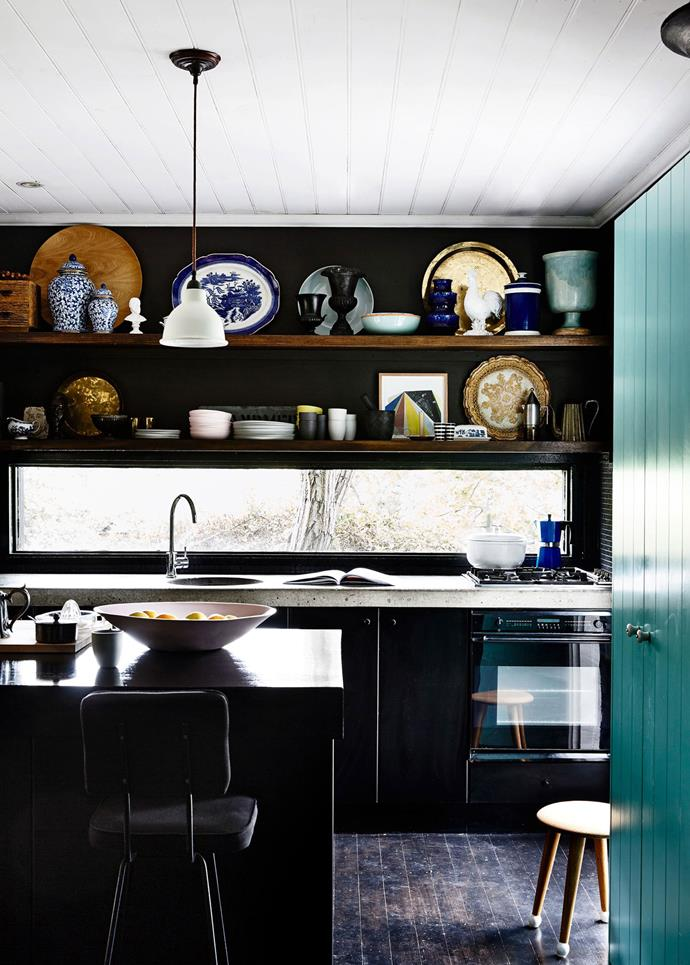 Black grounds the eclecticism of this rural kitchen, keeping it feeling modern and contemporary. *Photo: Derek Swalwell*