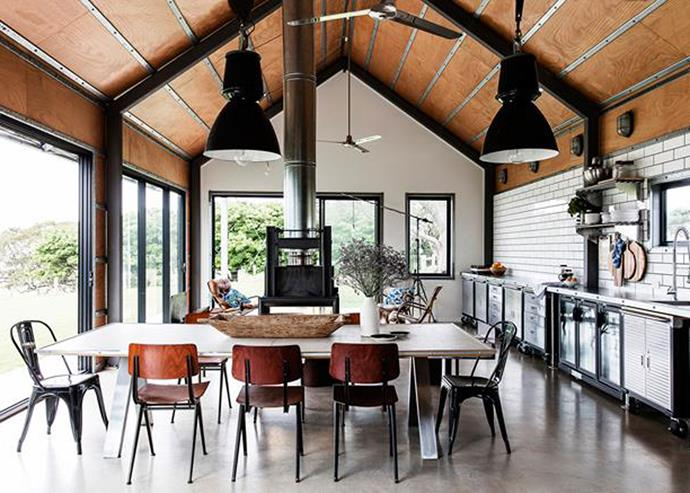The kitchen and dining area takes pride of place this industrial-style [shed conversion on the NSW South Coast](http://www.homestolove.com.au/shed-conversion-how-to-build-a-stylish-holiday-house-for-less-4882). *Photo: Maree Homer*