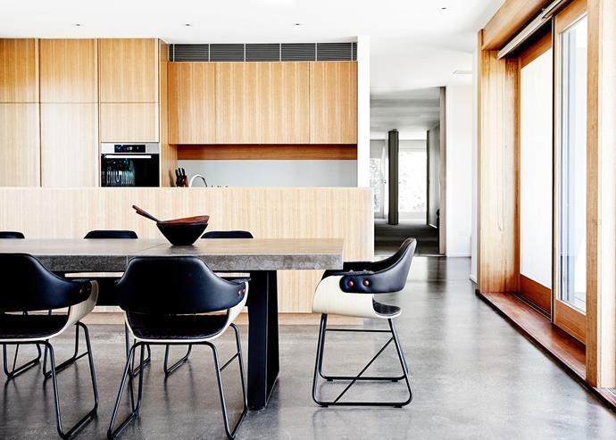 Concrete, marble and wood combine in a super-contemporary kitchen and dining space as part of this [revamped '70s farmhouse](http://www.homestolove.com.au/contemporary-revamp-for-70s-farmhouse-2640) *Photo: James Geer*