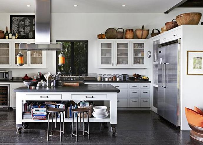 Haphazard placement of crockery and vases help add to the relaxed, inviting feel of this country kitchen. *Photo: Martin Lof*