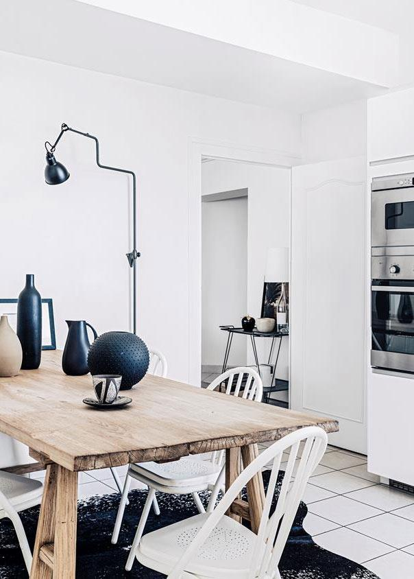 "Midnight blue accents break up the all-white palette in this [heritage apartment](http://www.homestolove.com.au/a-beautifully-pared-back-heritage-apartment-in-lyon-4826|target=""_blank"") in Lyon. Photo: Felix Forest"