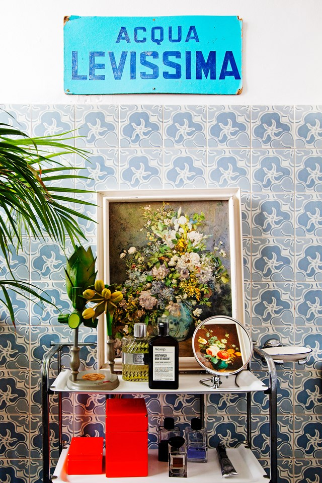 "Grooming essentials and an oil painting sit atop a reclaimed trolley in the bathroom of [illustrator Liselotte Watkins' home](https://www.homestolove.com.au/work-of-art-a-home-inspired-by-colour-4903|target=""_blank""). If you're not ready to tackle a large-scale upcycling project, then start with smaller items – like a vintage trolley, or some trinkets - and don't be afraid to reinvent their purpose. *Photo:* Helenio Barbetta"