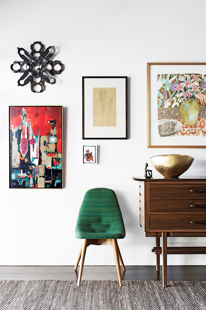 Mid-century furniture anchors this central space, including a sideboard by Schulim Krimper and a  vintage Danish chair. Artworks (clockwise from left) by Erica McGilchrist, Louis Kahan, Greg Irvine and Dan Kandy. Bash vessel, Tom Dixon.