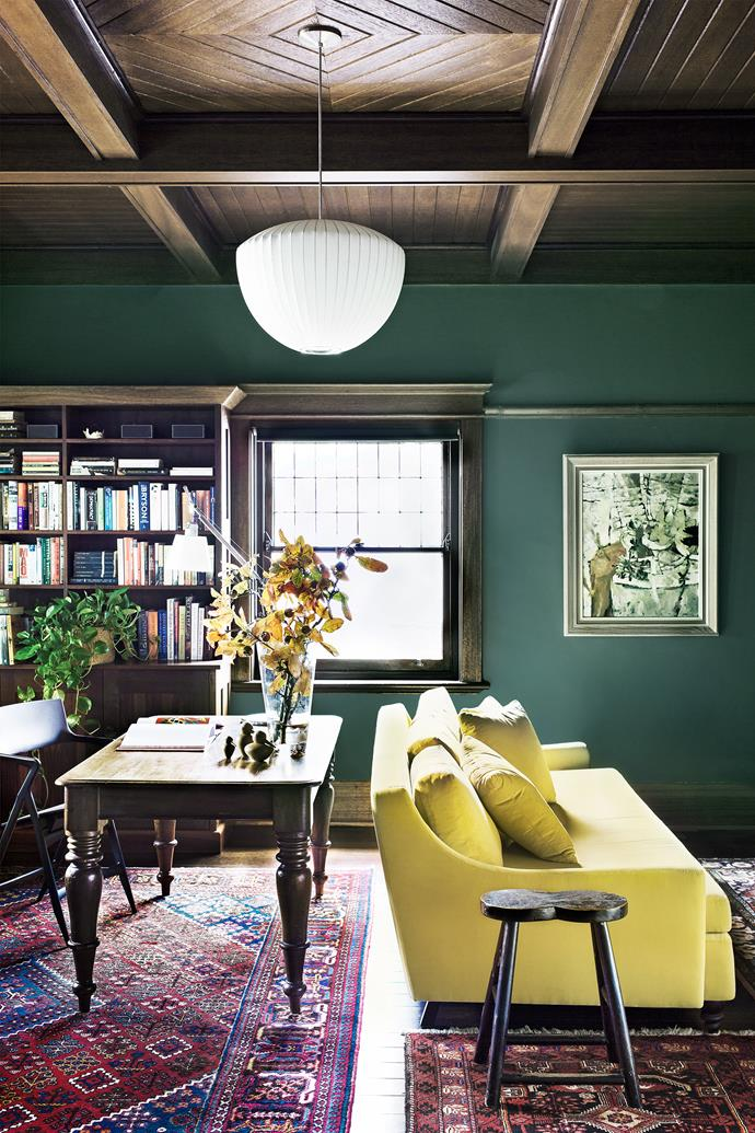 """""""We love the original rosewood ceiling, it's quite rare for a California bungalow,"""" says Jennifer. The contemporary sofa with turned legs coexists harmoniously with an early Australian library table in black bean timber and an antique Chinese stool."""
