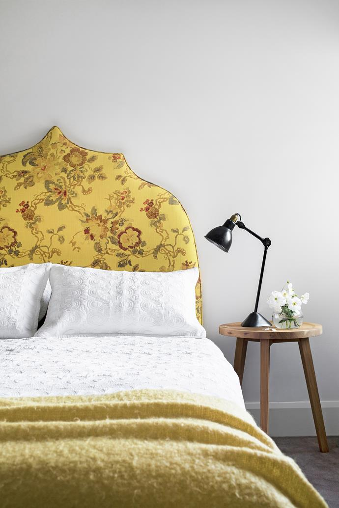 Botanical images are found throughout the room to echo the floral theme of the romantic bedhead, designed by Sally Richardson.