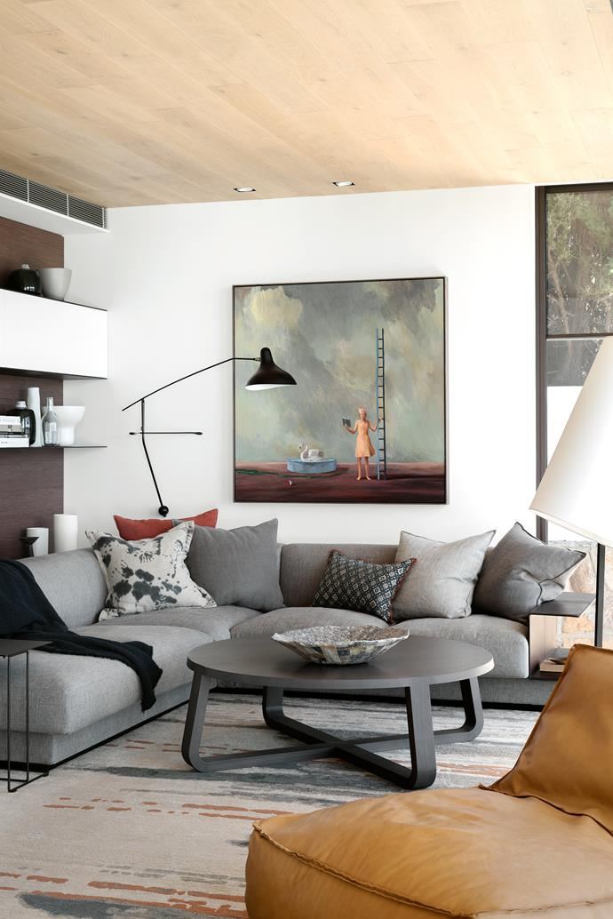 In the TV room, a Walter Knoll 'Yuuto' sofa from Living Edge, a Verzelloni 'Zoe' lounge chair from Stylecraft and a 'Jade' coffee table from Zuster sit on a Hare + Klein 'Swept' rug from Designer Rugs.