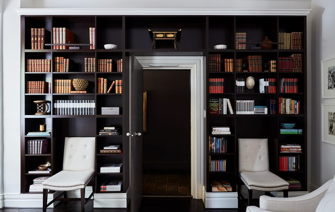 Custom-joinery creates a clever use of space in this small apartment and makes for a magnificent home library!