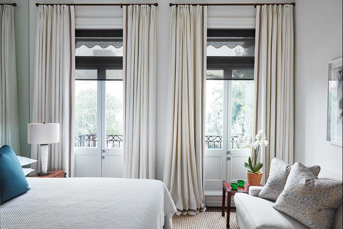 Cushions in Fortuny textiles from Ascraft, add a soft touch to the elegant master bedroom.
