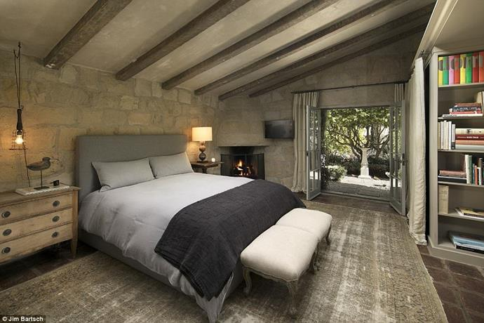 Raw and natural tones and textures create a serene environment in the bedroom.