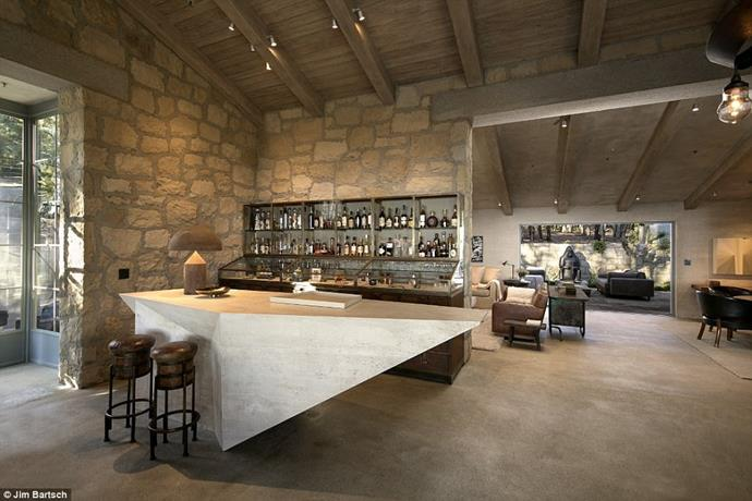 Exposed timber beams, stone walls and several fireplaces, create a luxurious European vibe.