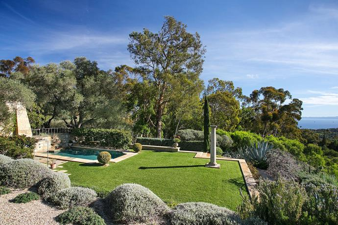 Picturesque gardens and natural bushland surround the breathtaking property.