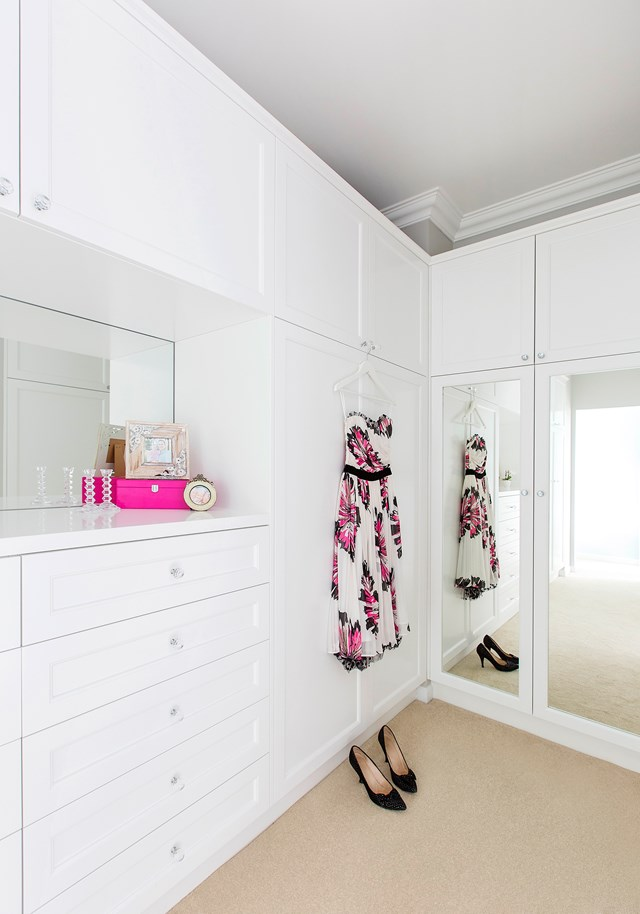 "Walk-in wardrobes, like this one in a [home combining Hampton's style with Hollywood glam](https://www.homestolove.com.au/weatherboard-house-combines-hamptons-style-with-hollywood-glamour-4966|target=""_blank""), provide an excellent place to get ready, while ensuring your master bedroom stays free from clutter. *Photo: Elouise Van Riet-Gray 