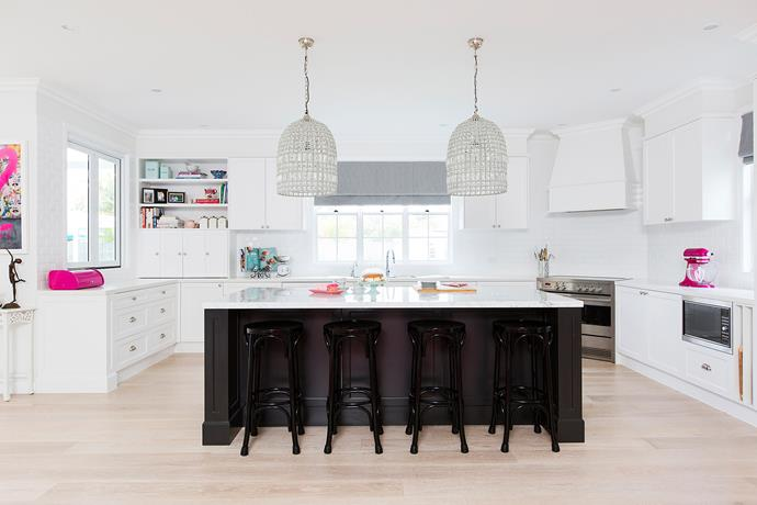 A Carrara marble island benchtop and Caesarstone countertops bring a sense of calm to a much-used space.