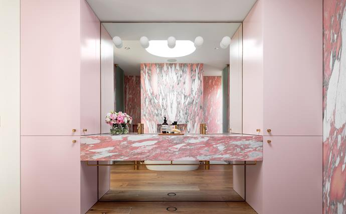 Pink Norwegian rose marble from Artedomus. Lighting by Flos. Brodware taps.