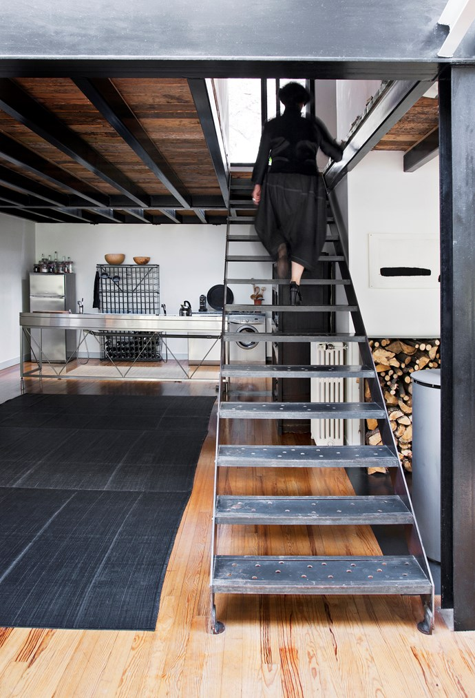 The stairs lead to the mezzanine level, which contains the bedroom, bathroom, workroom and a terrace at the back, from which light flows into the kitchen below through a couple of skylights.