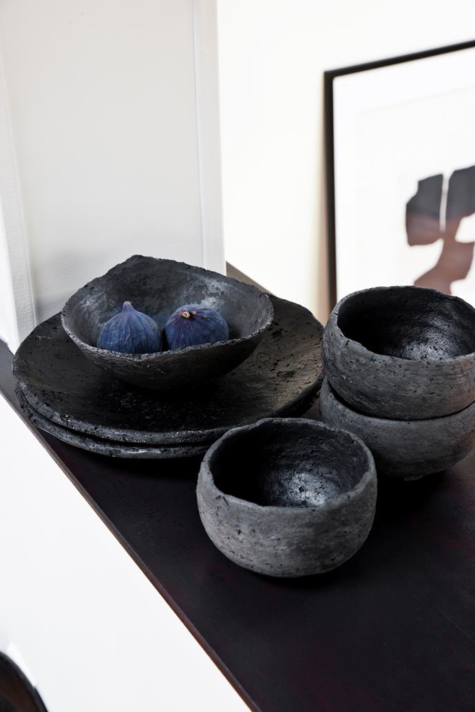 A selection of Setsuko's bowls, platters and plates are displayed on the shelf of the internal window between the living room and kitchen.