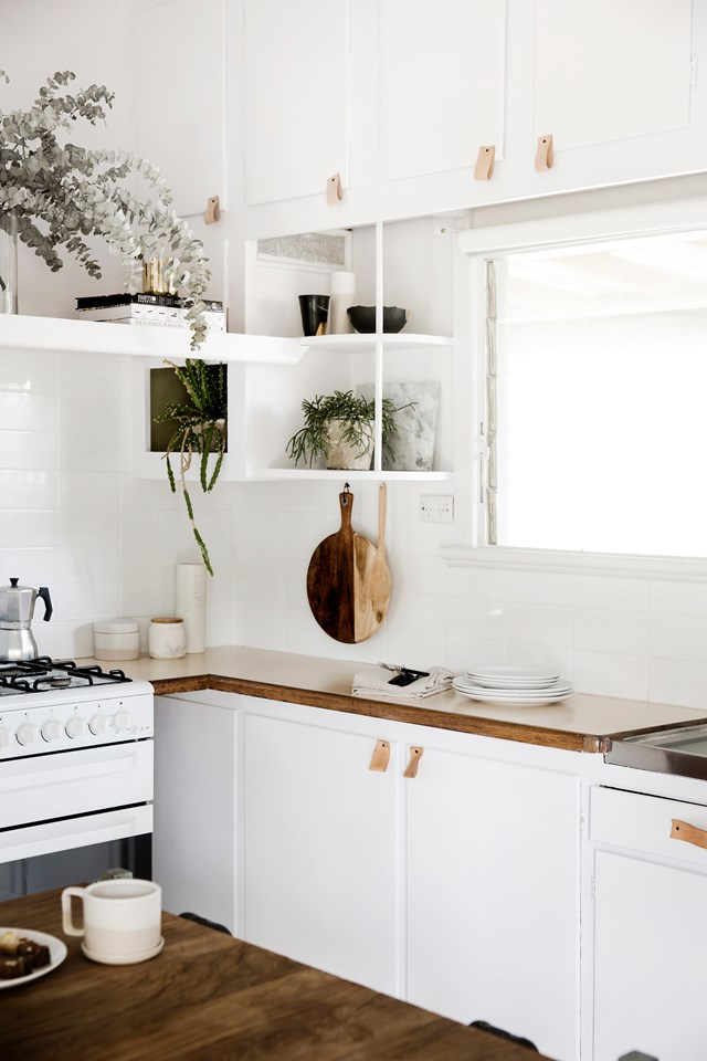 Light tan leather pulls look great in this light and bright Scandi-style kitchen.