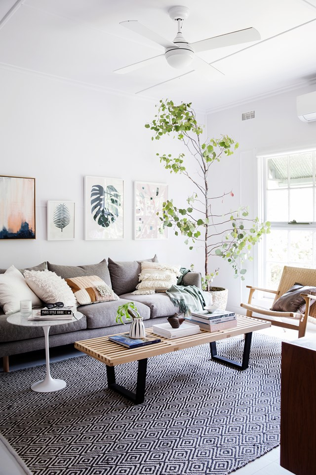 "Interior designers Joshua Reitano and Adriana Vujovic, inherited this [mid-century cottage on the Mornington Peninsula](https://www.homestolove.com.au/diy-couple-share-real-life-home-renovation-advice-4987|target=""_blank""), Victoria, from Joshua's late grandpa in 2014. In just six months, the design-savvy couple transformed the dark and dingy shack into a light-filled coastal abode that they now call home. *Photo: Chris Warnes* 