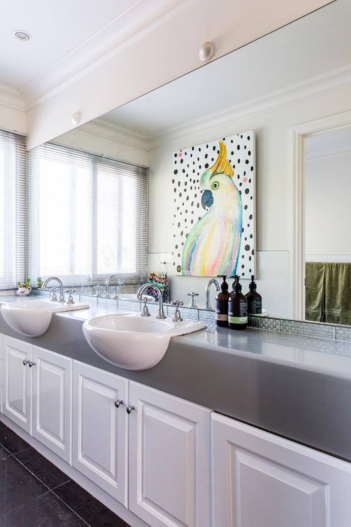 Lizzie's artwork bring life and colour to the family bathroom.
