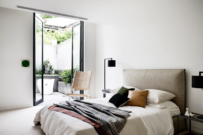 Molteni&C 'D.270.2' armchair by Giò Ponti, Anta 'Afra' floor lamp, Molteni&C 'Ribbon' bed, Moroso 'Little Albert' outdoor chair, all from Hub.