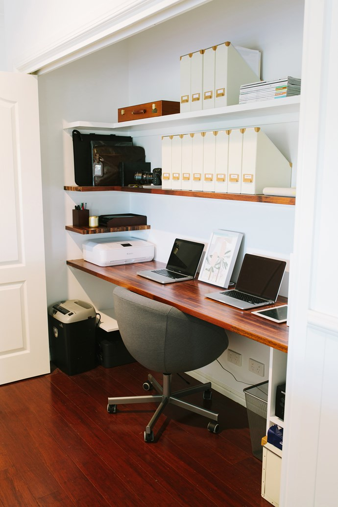 """Rather than waste a whole room on filing cabinets and """"junk"""", Lucy and Steve opted for a study area incorporated into their living room.  Cost-effective storage from Ikea keeps the space neat and organised."""