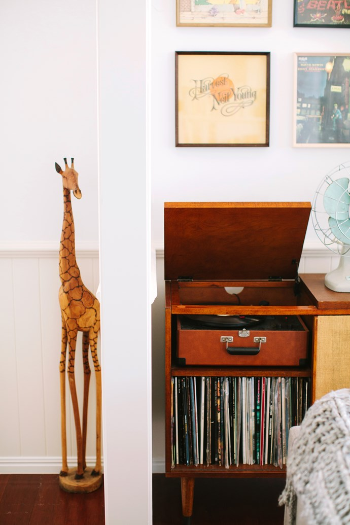 A vintage record player and frame vinyl add to the retro look.
