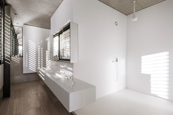 Corian walls in the bathroom have openings to admit light.