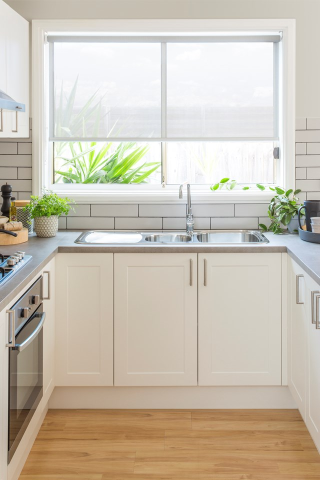 """These investment property owners updated their tired rental kitchen with an affordable and stylish [DIY flatpack renovation](https://www.homestolove.com.au/diy-flatpack-kitchen-renovation-for-under-6000-5026