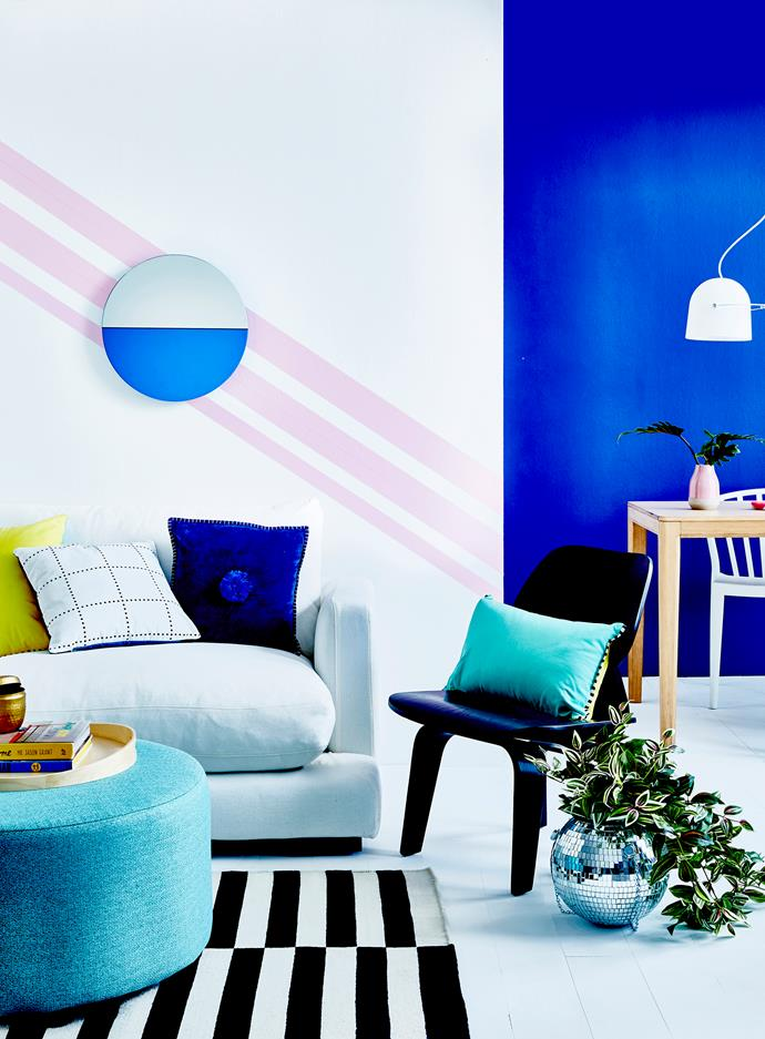 Pair vibrant colours with white walls and bold monochrome furniture piece.