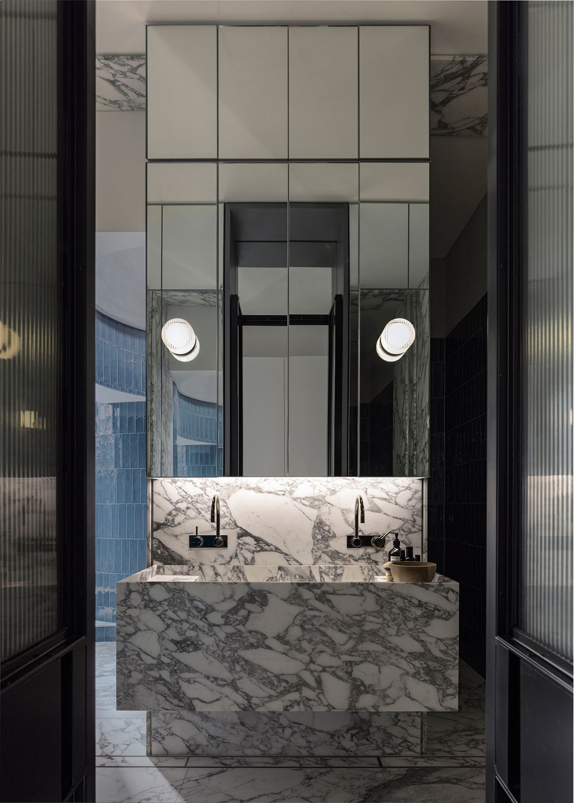 "A pair of black French doors create an entrance fit for a grand bathroom in this [rooftop Sydney apartment](https://www.homestolove.com.au/a-rooftop-sydney-apartment-and-garden-5877|target=""_blank""). *Photo: Felix Forest / Story: Belle*"