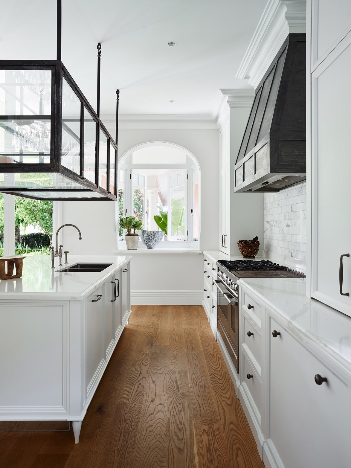 """<p>**SUSPENDED SHELVING ABOVE KITCHEN ISLAND**<p> <p>While the masses may opt for a trio of stylish [kitchen island pendant lights](https://www.homestolove.com.au/kitchen-pendant-lights-6391 